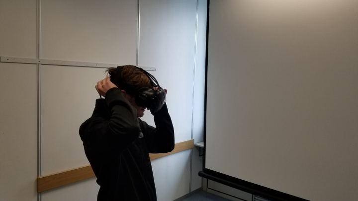 Iowa State student Jason Becker equips an HTC Vive VR headset at the TU Wien HCI Lab.