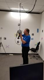 Dr. Gerhard Navratil prepares the Meta AR goggles for use.