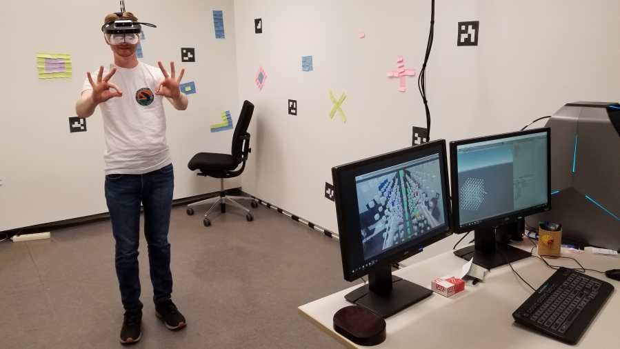 Jason Becker tries out some hand motions to manipulate data in augmented reality.