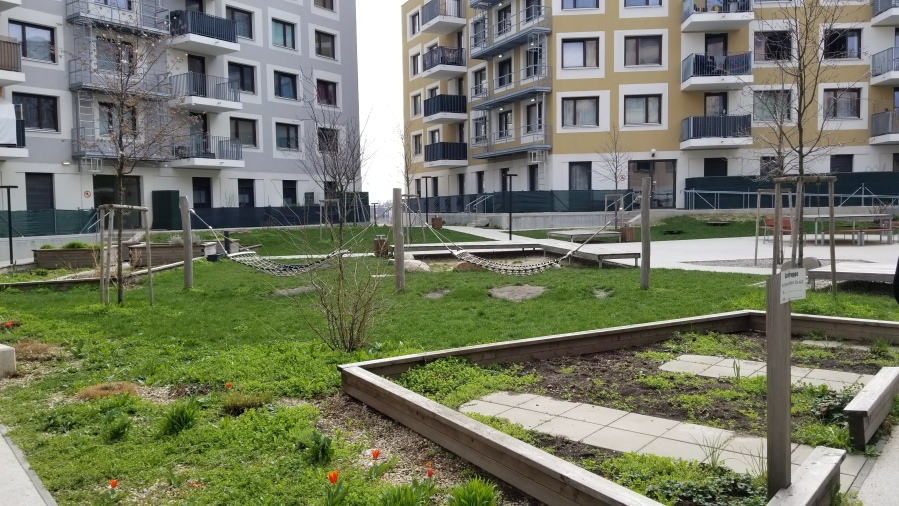 A raised courtyard in Aspern. While all the courtyards are open to the public, this one is raised one level to provide some privacy, while also covering the top level of a parking garage, which couldn't be built underground due to the high water table in Aspern.