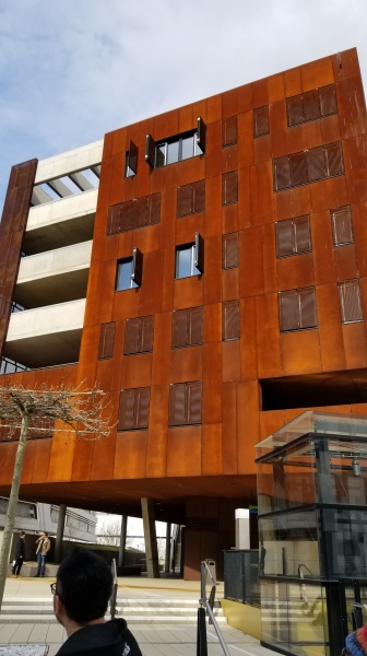 """The TC/D1 (Teaching Center and Departments) building at WU Vienna, built with a special material designed to develop a protective """"rust"""" patina over time."""
