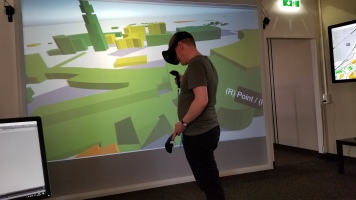 One of our presenters demonstrates the VR model of Vienna Airport power usage.