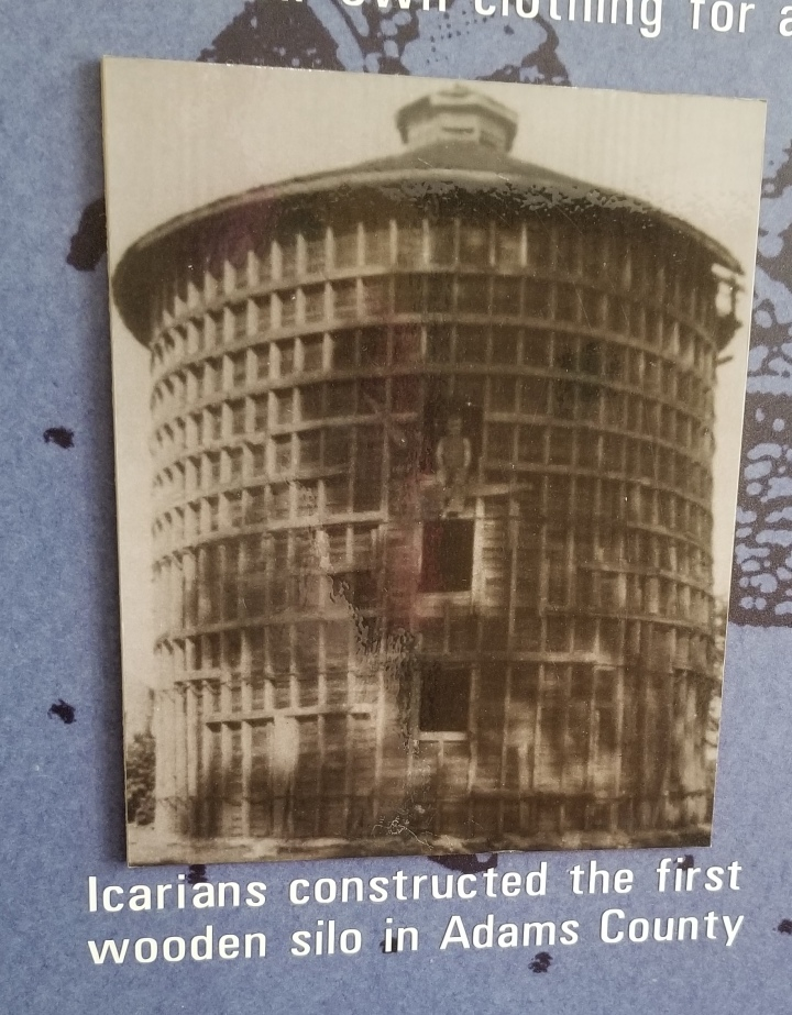 """An image of an Icarian wooden silo captioned """"Icarians constructed the first wooden silo in Adams County."""""""