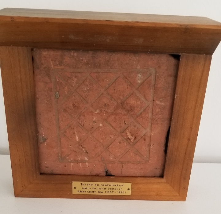 An Icarian-manufactured brick with a crosshatched pattern.
