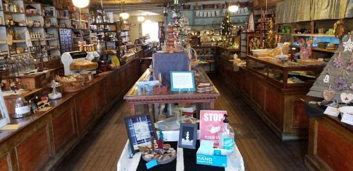 The interior of the High Amana General Store, a brightly lit cluttered store space.